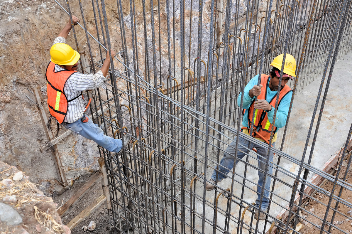 Workers climbing on a rebar framework